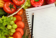Fresh Vegetables and fruits with a blank book Royalty Free Stock Photography