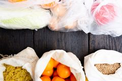 Fresh vegetables and fruits in eco cotton bags against vegetables in plastic bags. Zero waste concept - Use plastic bags or multi- stock photos
