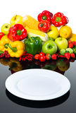Fresh vegetables and fruits with empty plate Royalty Free Stock Photography