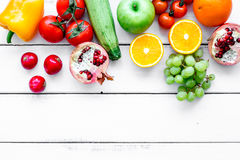 Fresh vegetables and fruits for fitness dinner on white background top view mockup Stock Photos