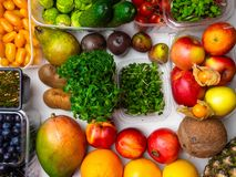 Fresh vegetables and fruits for fitness dinner on white background top view mockup royalty free stock photo