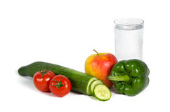 Fresh vegetables and fruits with a glass of water Royalty Free Stock Photography