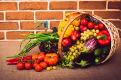 Fresh vegetables, fruits and lettuce on kitchen table. Healthy l. Fresh vegetables, fruits and lettuce on kitchen table. Warm toned. Horizontal Royalty Free Stock Photography