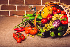 Fresh vegetables, fruits and lettuce on kitchen table. Healthy l. Fresh vegetables, fruits and lettuce on kitchen table. Warm toned. Horizontal Stock Image