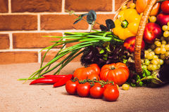 Fresh vegetables, fruits and lettuce on kitchen table. Healthy l. Fresh vegetables, fruits and lettuce on kitchen table. Warm toned. Horizontal Royalty Free Stock Photos