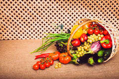 Fresh vegetables, fruits and lettuce in wicker basket. Warm toned. Horizontal Royalty Free Stock Image