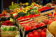 Fresh vegetables and fruits in the market. Fresh pinches, tomatoes, salad, pumpkins, oranges, peppers, and other vegetables and fruits in the market Royalty Free Stock Photography