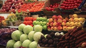 Fresh vegetables and fruits on the shelves. Showcase fruits and vegetables. Fresh vegetables and fruits on the shelves farm market stock video