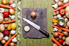 Fresh vegetables and fruits on vintage background - detox, diet or healthy food concept. Copy space. Stock Photos