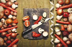 Fresh vegetables and fruits on vintage background - detox, diet Royalty Free Stock Photos
