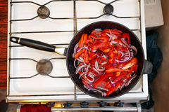 Fresh vegetables in a frying pan, cooking food at home kitchen Royalty Free Stock Photos