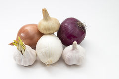 Fresh vegetables garlic and onions isolated on the Royalty Free Stock Photography