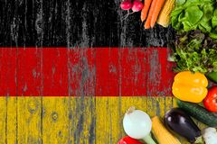 Fresh vegetables from Germany on table. Cooking concept on wooden flag background royalty free stock images