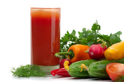 Fresh vegetables and glass of tomato juice. Many fresh juicy vegetables on a white background Royalty Free Stock Photo
