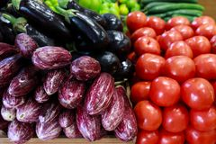 Fresh vegetables in the greek grocery shop. Fresh vegetables eggplants, tomatoes, cucumbers, peppers on the counter in the greek grocery shop. Horizontal. Close stock photography