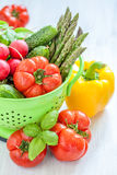 Fresh vegetables in green colander Royalty Free Stock Images