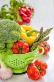 Fresh vegetables in green colander Stock Photos