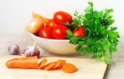 Fresh vegetables and green stuff. Fresh vegetables and greenstuff on wooden board Royalty Free Stock Photo