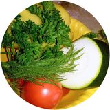 Fresh vegetables and greens in a yellow bowl. stock images