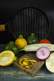 Fresh vegetables for grill - yellow and green zucchini, red onio. Vegetables for grill - yellow and green zucchini, red onion, eggplant and grill pan on dark Stock Photos