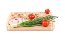 Fresh vegetables and ham on cutting board. Royalty Free Stock Photos