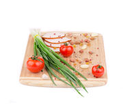 Fresh vegetables and ham on cutting board. Stock Image