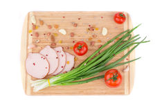 Fresh vegetables and ham on cutting board. Royalty Free Stock Photo