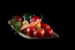 Fresh vegetables in a handmade natural real rectangular wood bow Royalty Free Stock Photos