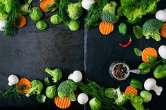 Fresh vegetables for a healthy diet. On a dark background in a rustic style. Vegetarian food. Top view Royalty Free Stock Image