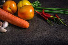 Fresh Vegetables for Healthy Diet on a rustic table and dark bac Stock Images
