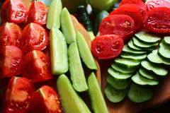 Fresh vegetables for a healthy diet. Fresh sliced ??tomatoes and cucumbers ready for eating Royalty Free Stock Photos