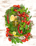 Fresh vegetables and herbs with olive oil Stock Photo