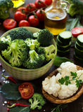 Fresh vegetables and herbs with olive oil Royalty Free Stock Image