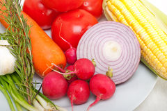 Fresh vegetables and herbs on a plate. Cooking raw ingredients on kitchen Stock Photo