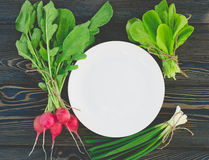 Fresh vegetables and herbs on a plate cooking raw ingredients on kitchen Royalty Free Stock Image