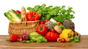 Fresh vegetables and herbs on white background Stock Photos