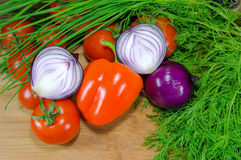 Fresh vegetables with herbs. On wood background royalty free stock images