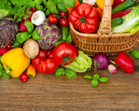 Fresh vegetables and herbs on wooden Royalty Free Stock Images