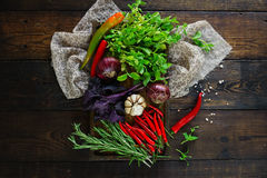 Fresh vegetables and herbs in wooden box, Raw organic healthy food. Fresh vegetables and herbs in wooden box in rustic style. Raw organic healthy food concept stock photos