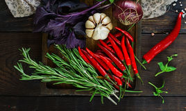 Fresh vegetables and herbs in wooden box, Raw organic healthy food. Fresh vegetables and herbs in wooden box in rustic style. Raw organic healthy food concept royalty free stock image