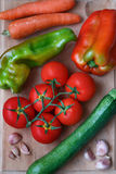 Fresh vegetables including tomatoes, zucchini, sweet green and red pepper, garlic, carrot Stock Photography