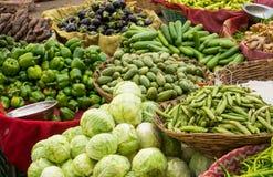 Fresh vegetables on indian market. Baskets of fresh vegetables on indian market Stock Photo