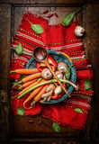Fresh vegetables ingredients in basket with cooking spoon on rustic napkin.  Vegetarian and healthy  food concept. Stock Image