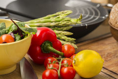 Fresh vegetables and ingredients in a kitchen Stock Photos