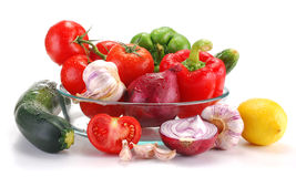 Fresh vegetables isolated on white. Vegetables with visible drops of water isolated on white Royalty Free Stock Image