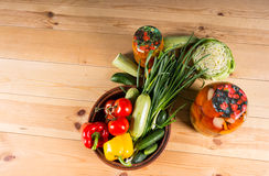 Fresh Vegetables and Jars of Preserves Royalty Free Stock Images