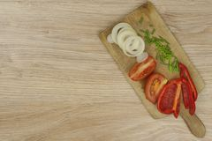 Fresh vegetables on a kitchen cutting board. Stock Image
