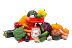 Fresh vegetables and kitchen scales. Royalty Free Stock Photo