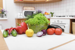 Fresh vegetables on kitchen table. Fresh vegetables for salad on a kitchen table Stock Photos