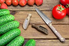 Fresh Vegetables, Knife, Pepper, Salt On The Wood Background. Fresh Vegetables And Knife On The Kitchen Rustic Rough Wooden Tabletop. Tomatoes, Cucumbers, Radish Stock Image
